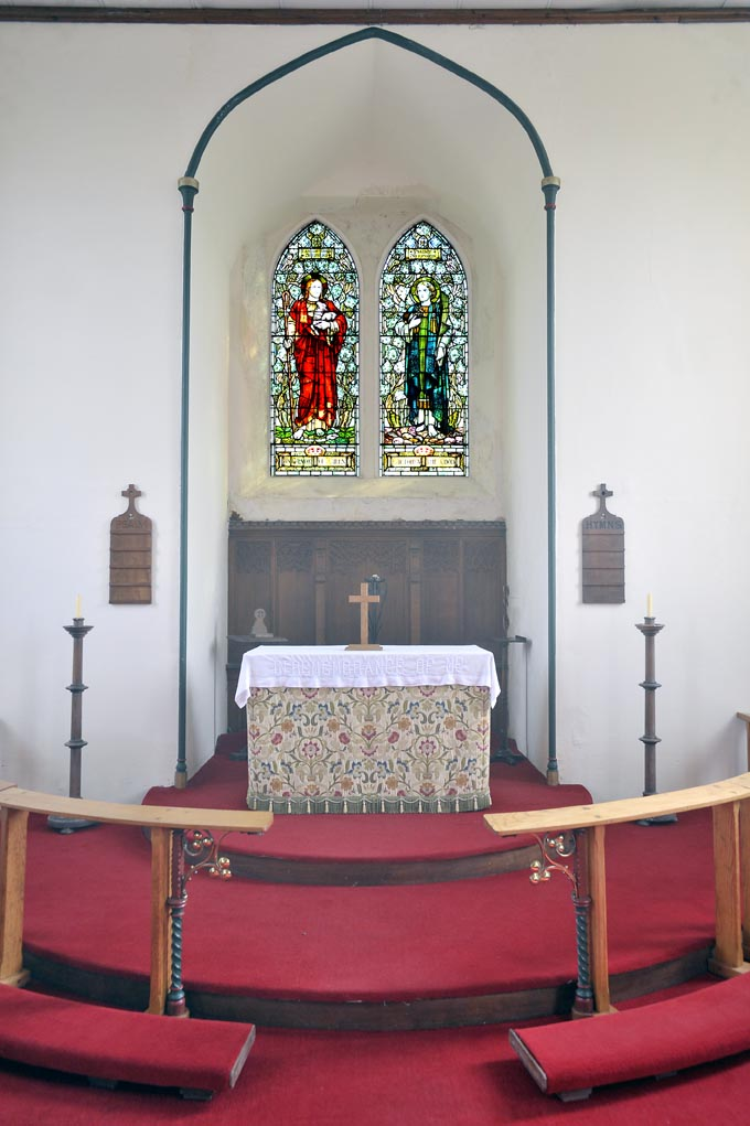 The Altar and Stained Glass Windows at New Hutton Church.