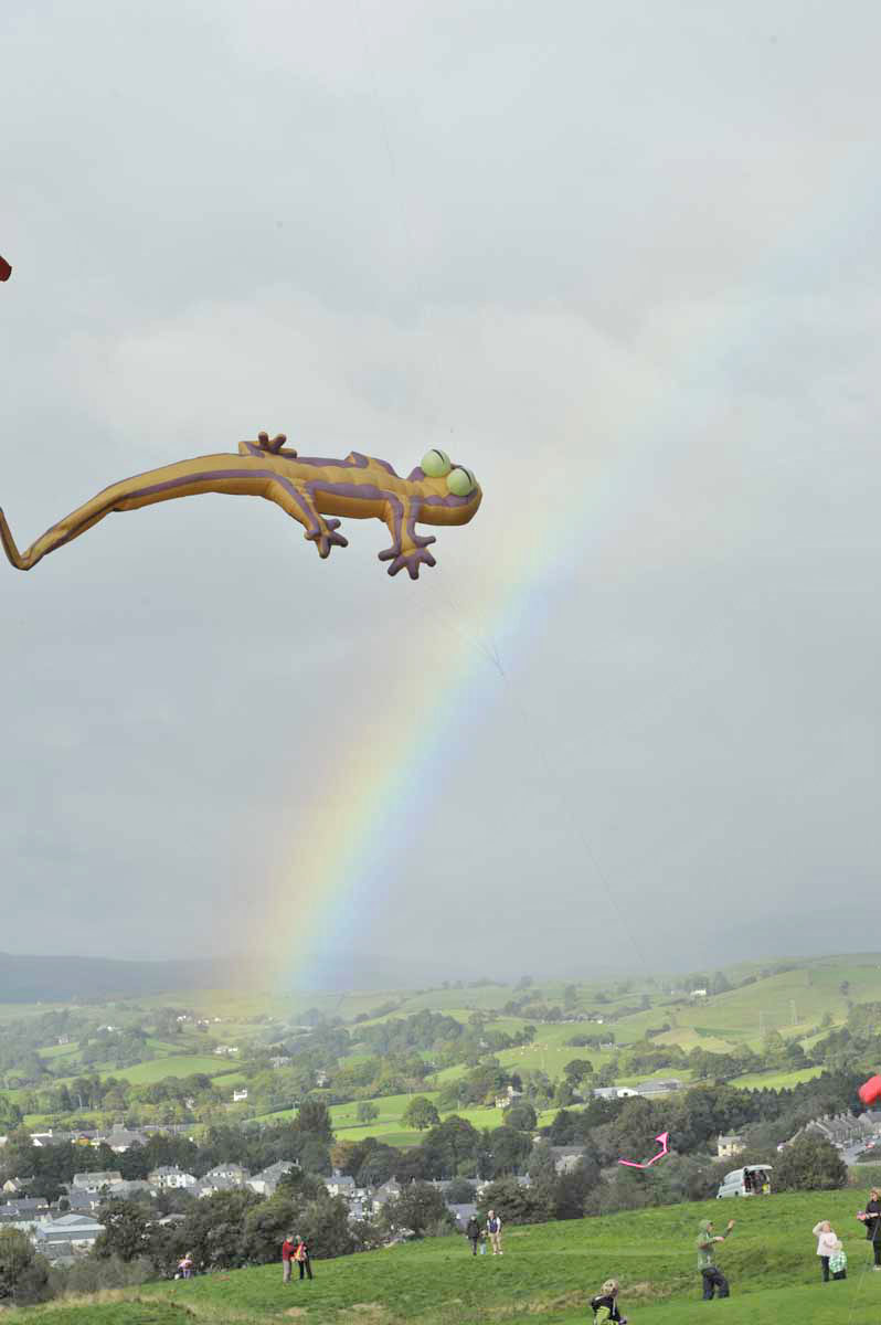 A kite in the shape of a giant lizard flies above Kendal Castle.