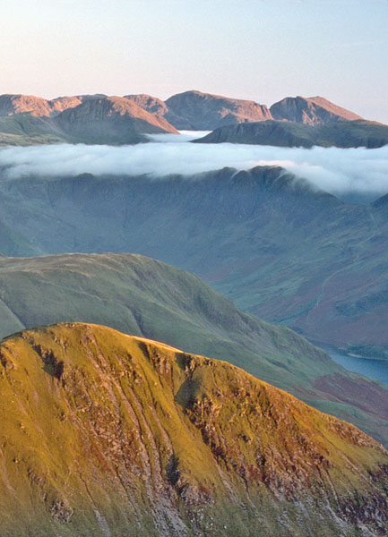 The Scafells beyond cloud rolling over Haystacks.