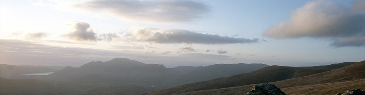 Clouds above the distant shape of Skiddaw.